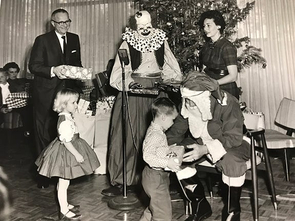 Santa gives presents to children, late 1950s