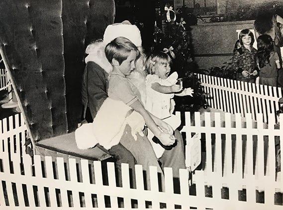Children visit Santa at University Mall, 1977