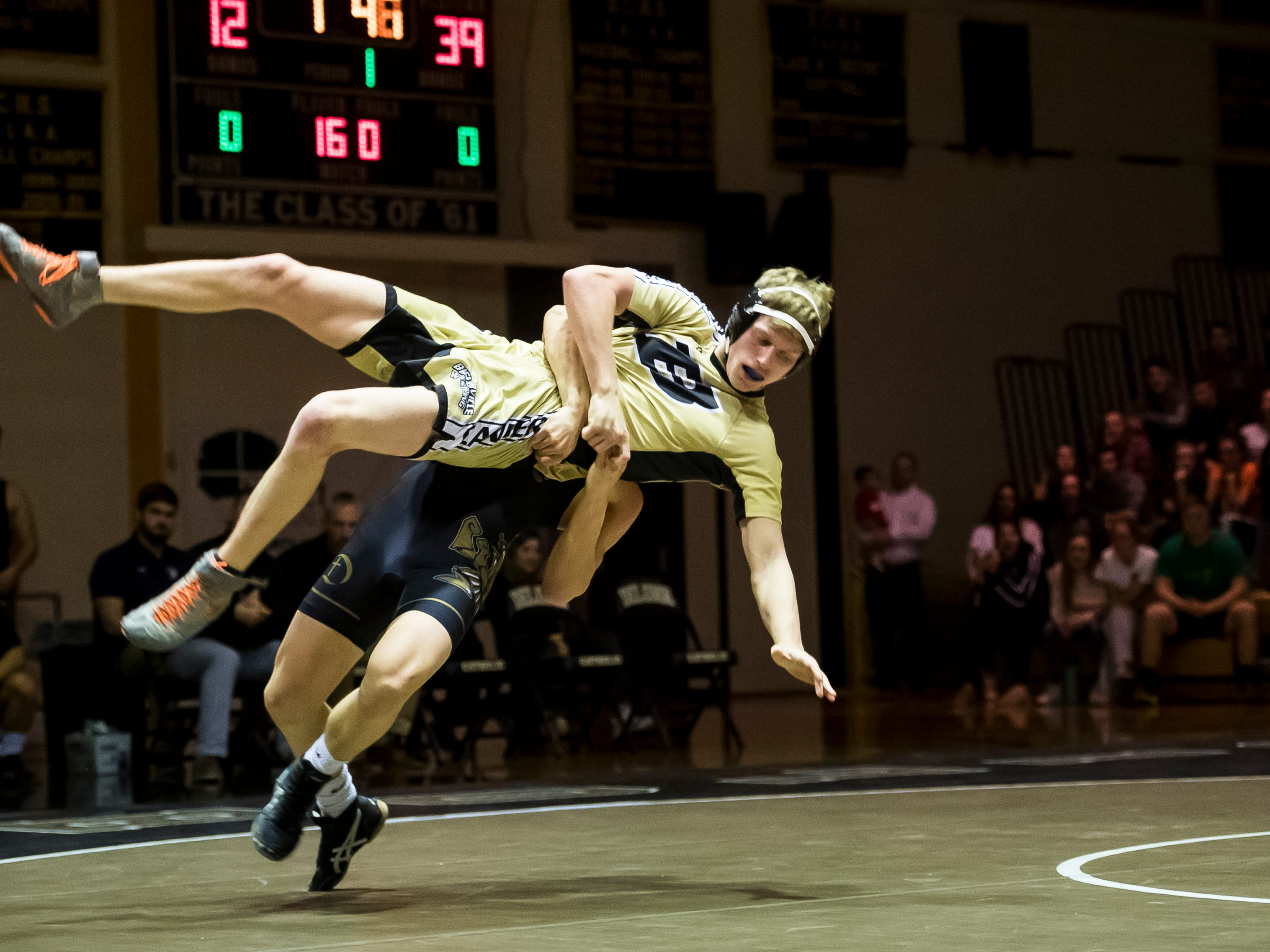 Delone Catholic's Robert Partenza takes down Biglerville's Tristan Metzger in the 160-pound bout at Delone Catholic High School on December 19, 2018. Partenza won 11-6 but the Canners won the duel 51-21.