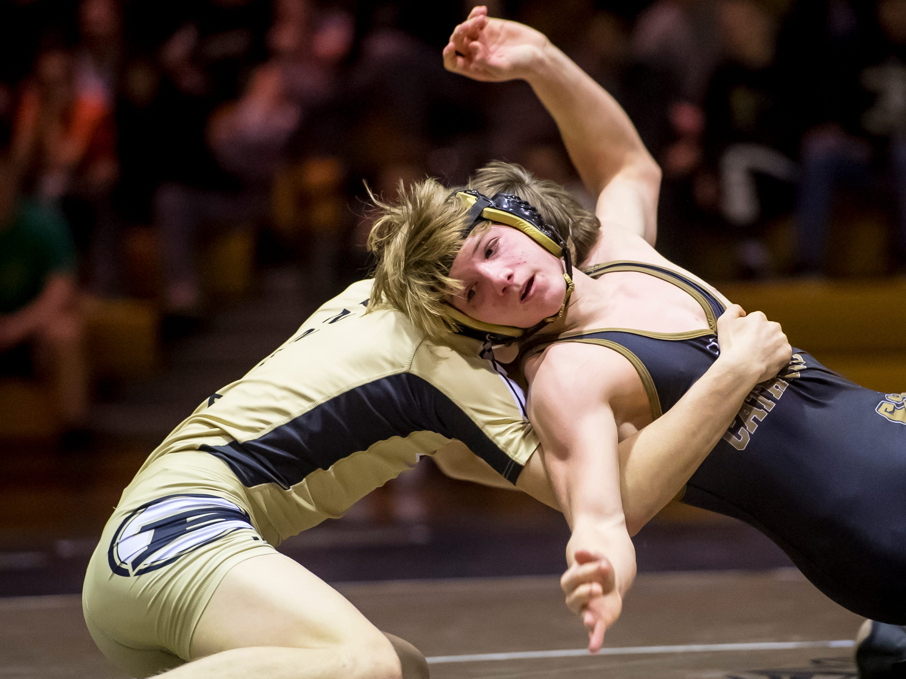 Biglerville's Eli Tuckey, left, wrestles Delone Catholic's Tate Neiderer in the 145-pound bout at Delone Catholic High School on December 19, 2018. Tuckey won by fall as the Canners won 51-21.