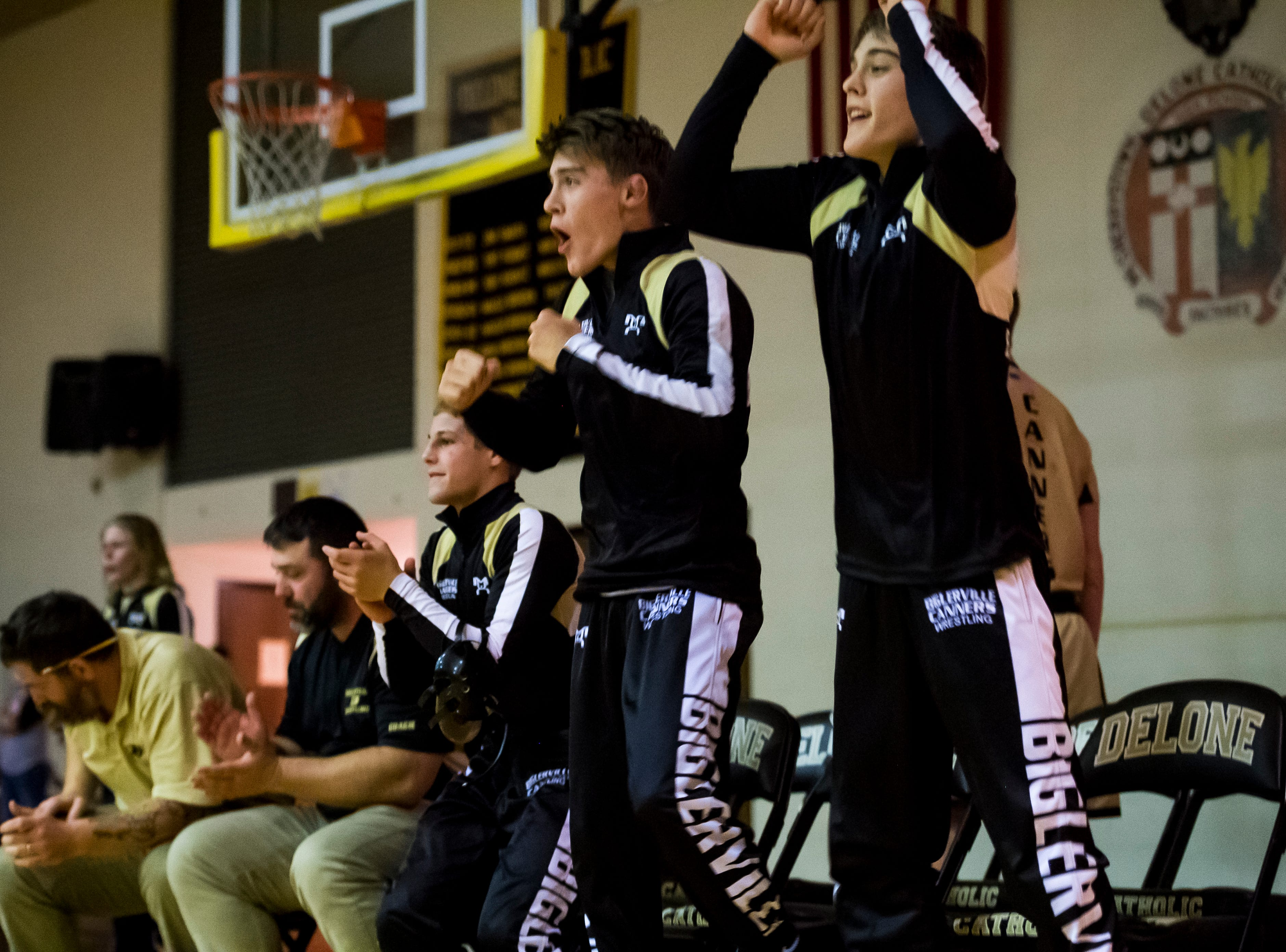 The Biglerville bench reacts as Johnny Sanchez pins Delone Catholic's Michael Deporter to give the Canners a 51-21 win at Delone Catholic High School on December 19, 2018.