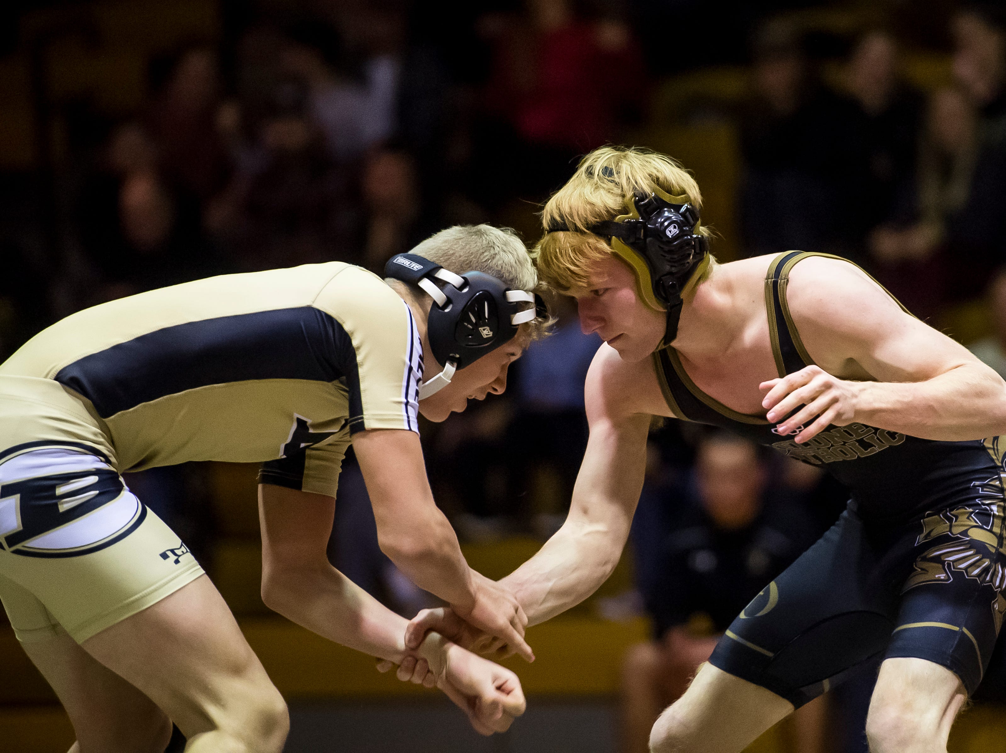 Delone Catholic's Harrison Cole, right, wrestles Biglerville's Gage Bishop in the 138-pound bout at Delone Catholic High School on December 19, 2018. Bishop won by fall and the Canners won the duel 51-21.