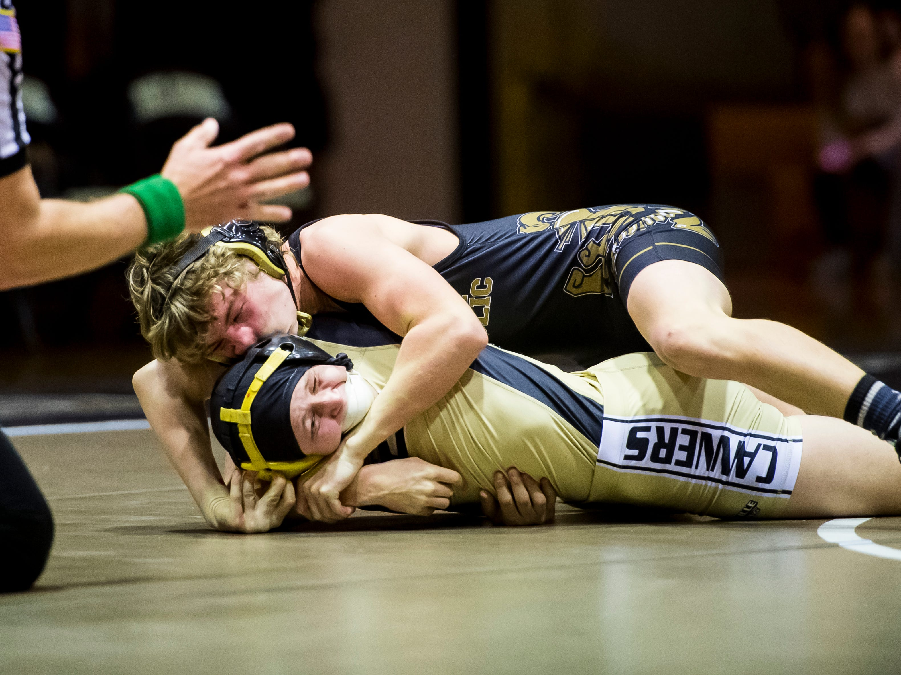 Delone Catholic's Nate Hart, top, wrestles Biglerville's Ethan Slaybaugh in the 113-pound bout at Delone Catholic High School on December 19, 2018. Slaybaugh won 7-4 and the Canners won the duel 51-21.