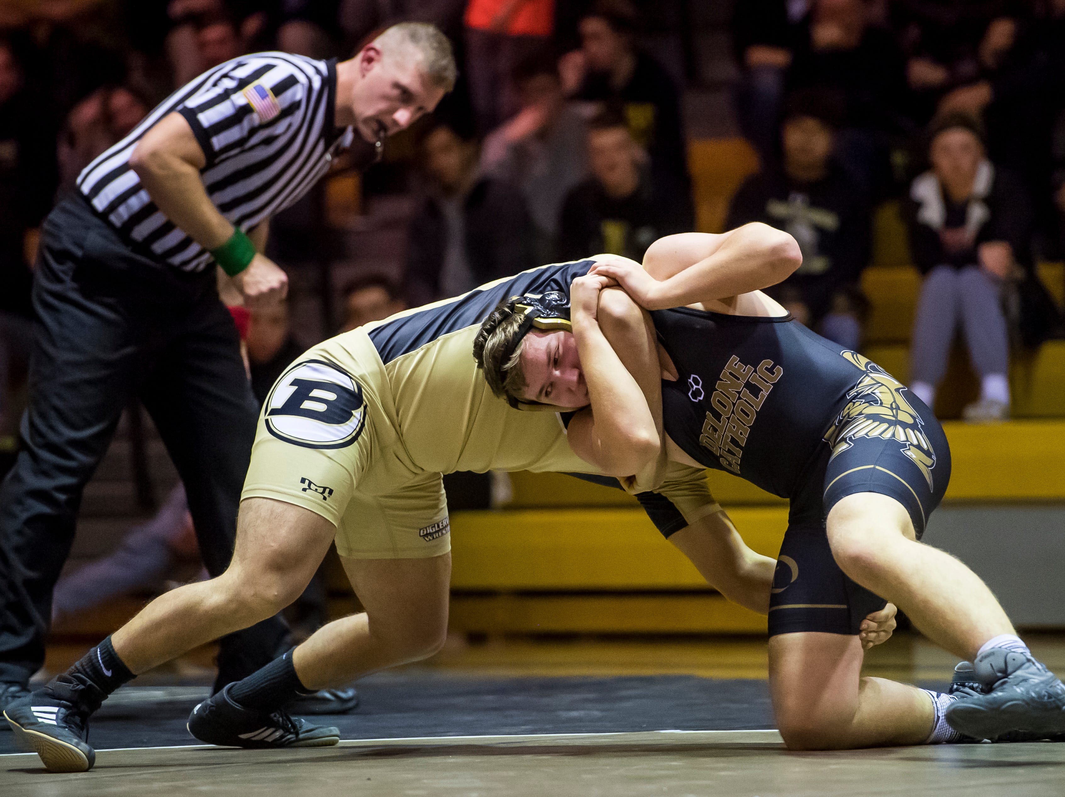 Delone Catholic's Michael Deporter, right, wrestles Biglerville's Johnny Sanchez in the 195-pound bout at Delone Catholic High School on December 19, 2018. Sanchez won by fall as the Canners won 51-21.