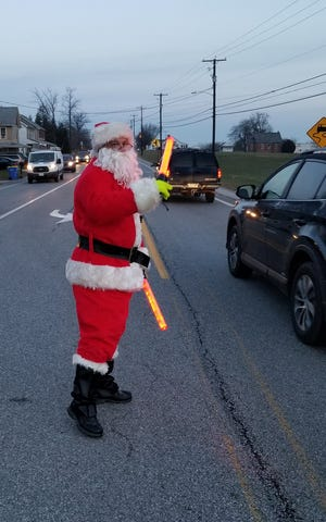 Captain Ed Allison of the Pleasant Hill Volunteer Fire Department was out directing traffic Thursday morning at West Manheim Elementary.