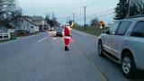 Santa Claus directed traffic Thursday morning at West Manheim Elementary School.