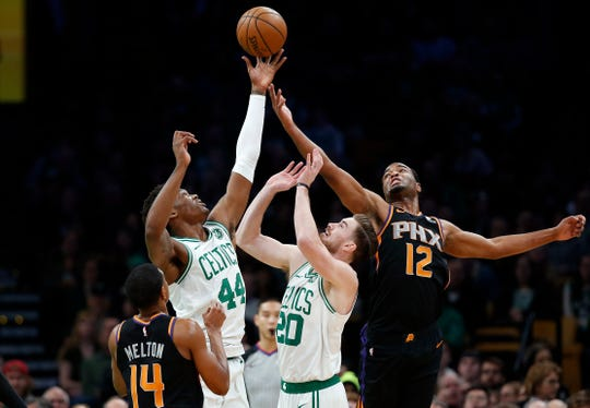 Dec 19, 2018; Boston, MA, USA; Boston Celtics center Robert Williams (44) reaches over Gordon Heyward (20) and Phoenix Suns forward T.J. Warren (12) for a loose ball during the first quarter at TD Garden. Mandatory Credit: Winslow Townson-USA TODAY Sports