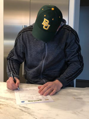 Davis DiVall signed his national letter of intent with Baylor on Wednesday, Dec. 19, 2018.