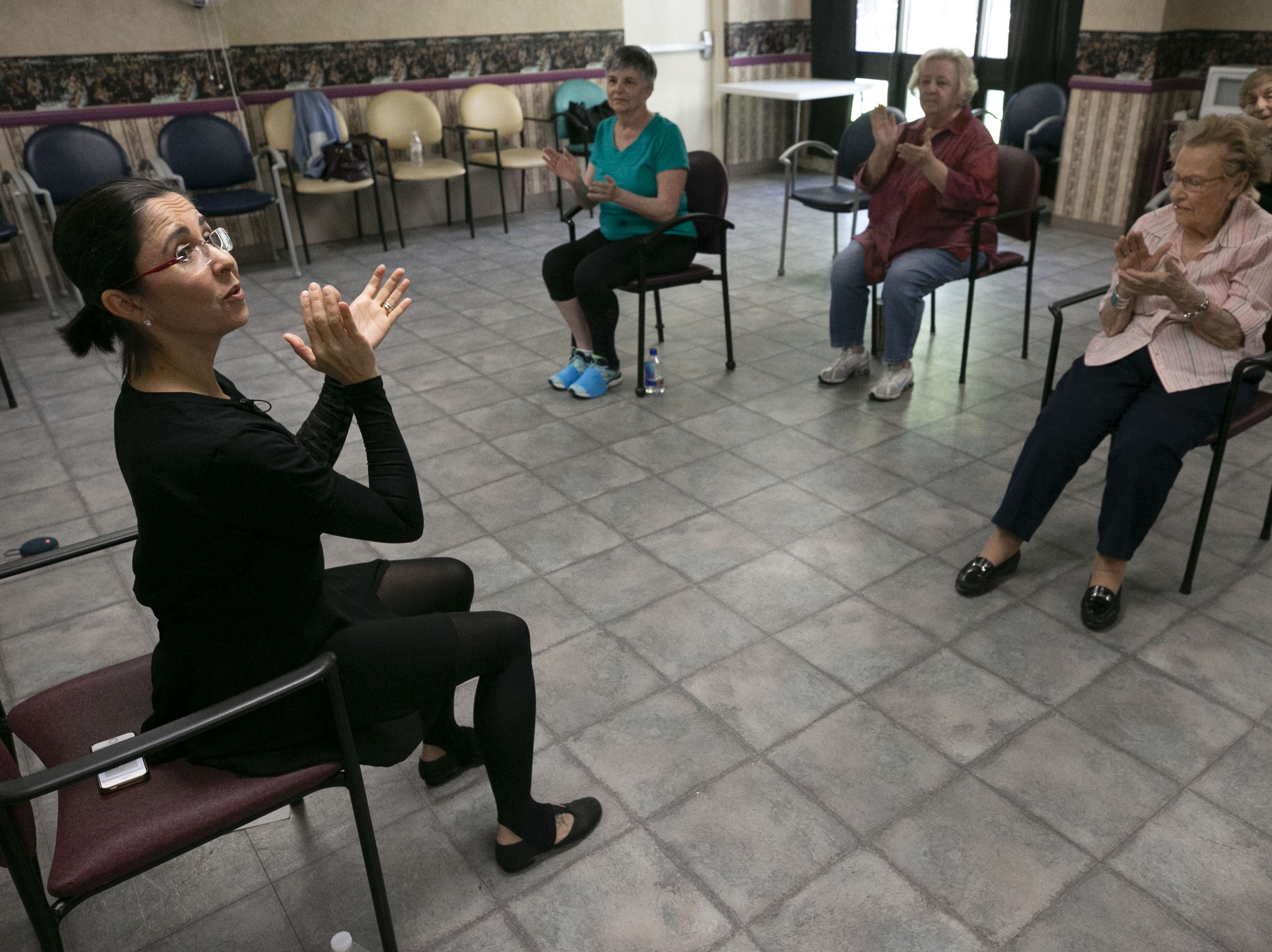 Fabiola Ambrosio, a faculty member with Ballet Arizona, leads a ballet class during Ballet Arizona's Creative Aging class at the Jewish Family & Children's Service Center for Senior Enrichment in the Palazzo Assisted Living Facility in Phoenix on Nov. 27, 2018.