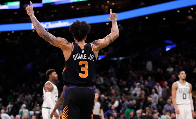 Kelly Oubre Jr. celebrates after the Suns' victory over the Celtics in his first game with Phoenix.