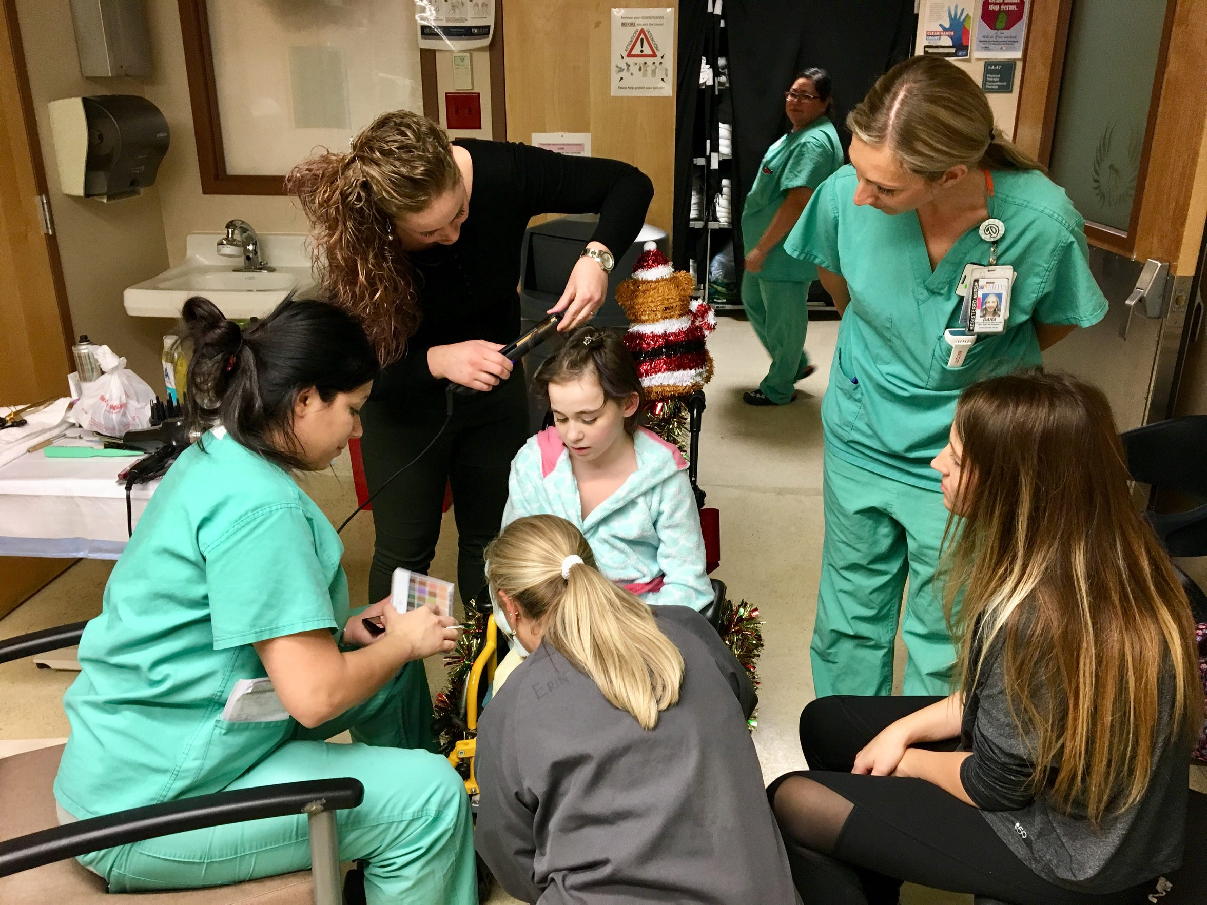 The staff at the Arizona Burn Center in Phoenix take time to help Isabella McCune get ready for her first night out of the hospital.