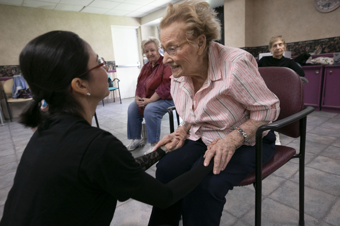 Fabiola Ambrosio, a faculty member with Ballet Arizona, talks with Betty Benyes, 100, following Ballet Arizona's Creative Aging class at the Jewish Family & Children's Service Center for Senior Enrichment in the Palazzo Assisted Living Facility in Phoenix on Nov. 27, 2018.