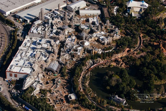Star Wars: Galaxy's Edge, a 14-acre land at Disneyland due to open summer 2019, rises behind the Rivers of America.