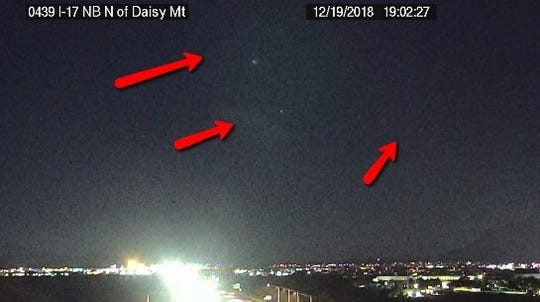 The Arizona Department of Transportation tweeted aphoto from a freeway camera on Interstate 17 north of Phoenixaimed at the night sky on Dec. 19, drawing attention at some unusual sightings, like red lights and gas clouds.