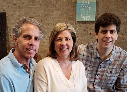 David Ghiz (left) and his family, wife Melanie and son Harrison, are continuing the family's legacy in the backyard living industry.