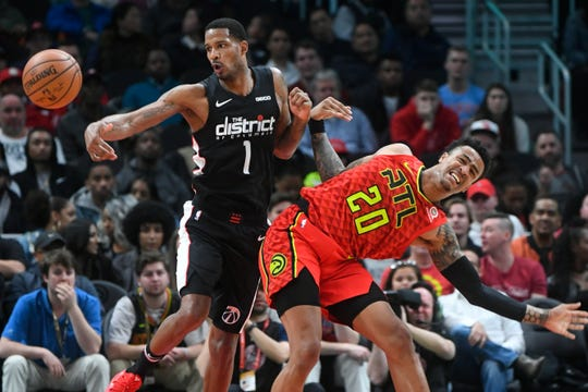 Wizards forward Trevor Ariza gets the ball away from Hawks forward John Collins during the second half of a game Dec. 18.