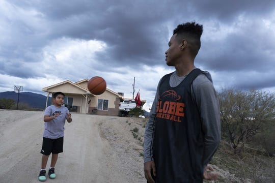 Globe senior basketball player B.J. Burries, who is on the verge of becoming the state's all-time leading scorer, at his home on the San Carlos Apache Indian Reservation.
