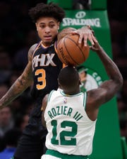 Kelly Oubre Jr. stuffs Celtics guard Terry Rozier during the second half of a game Dec. 19 at TD Garden.