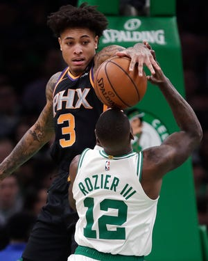 Kelly Oubre Jr. gets his hand on the ball as Celtics guard Terry Rozier tries to put up a shot during a game Dec. 19 at the TD Garden.