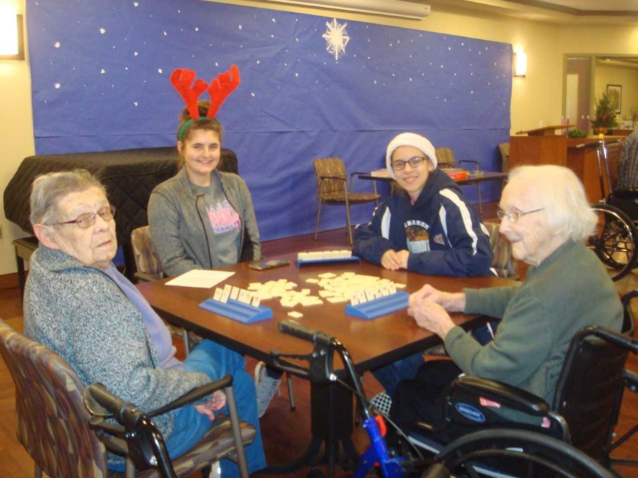 Lebanon Catholic girls basketball players recently spread some holiday cheer to residents at Cornwall Manor