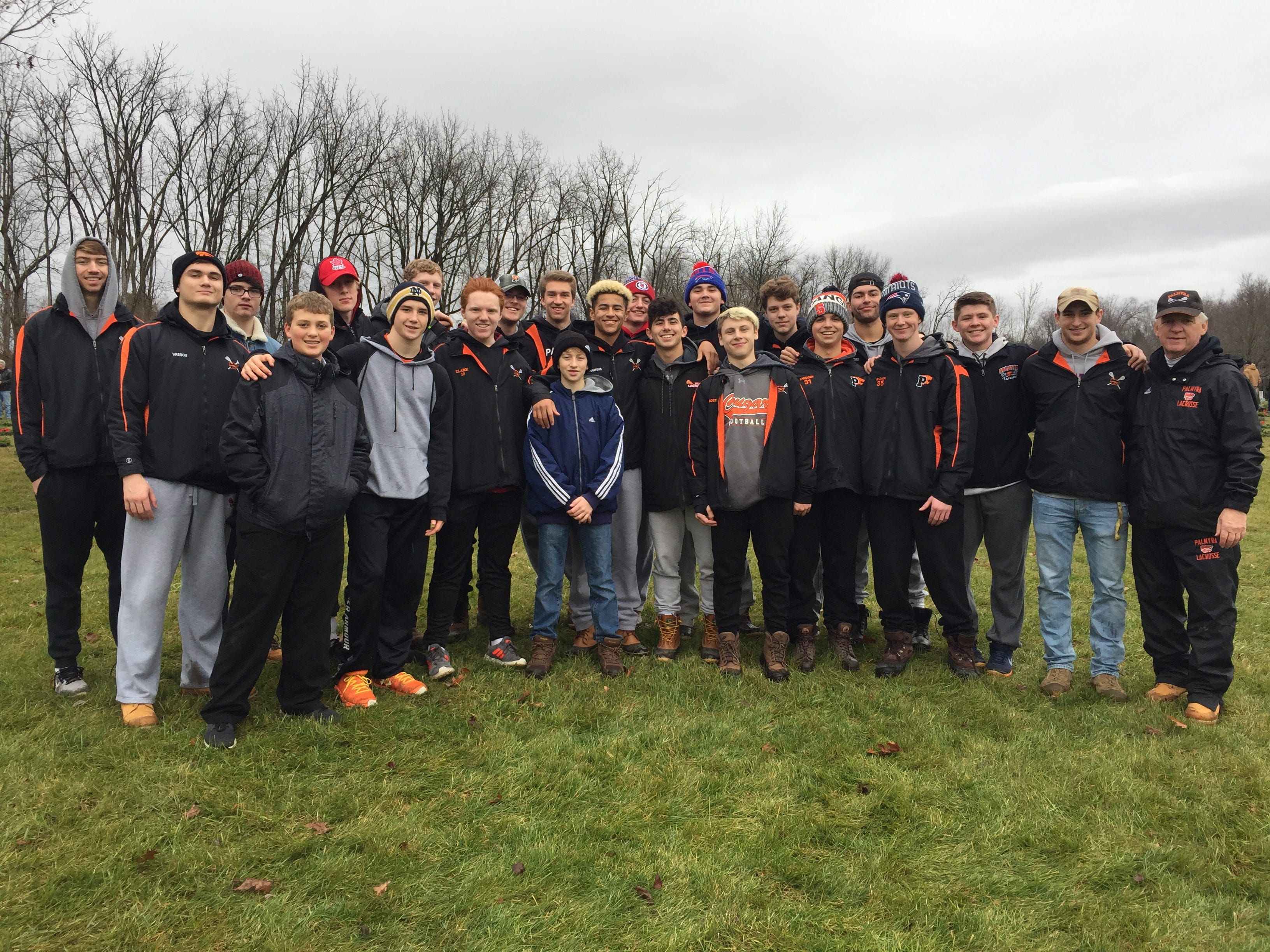 The Palmyra boys lacrosse team poses for a photo after taking part in the Wreaths Across America event last Saturday.