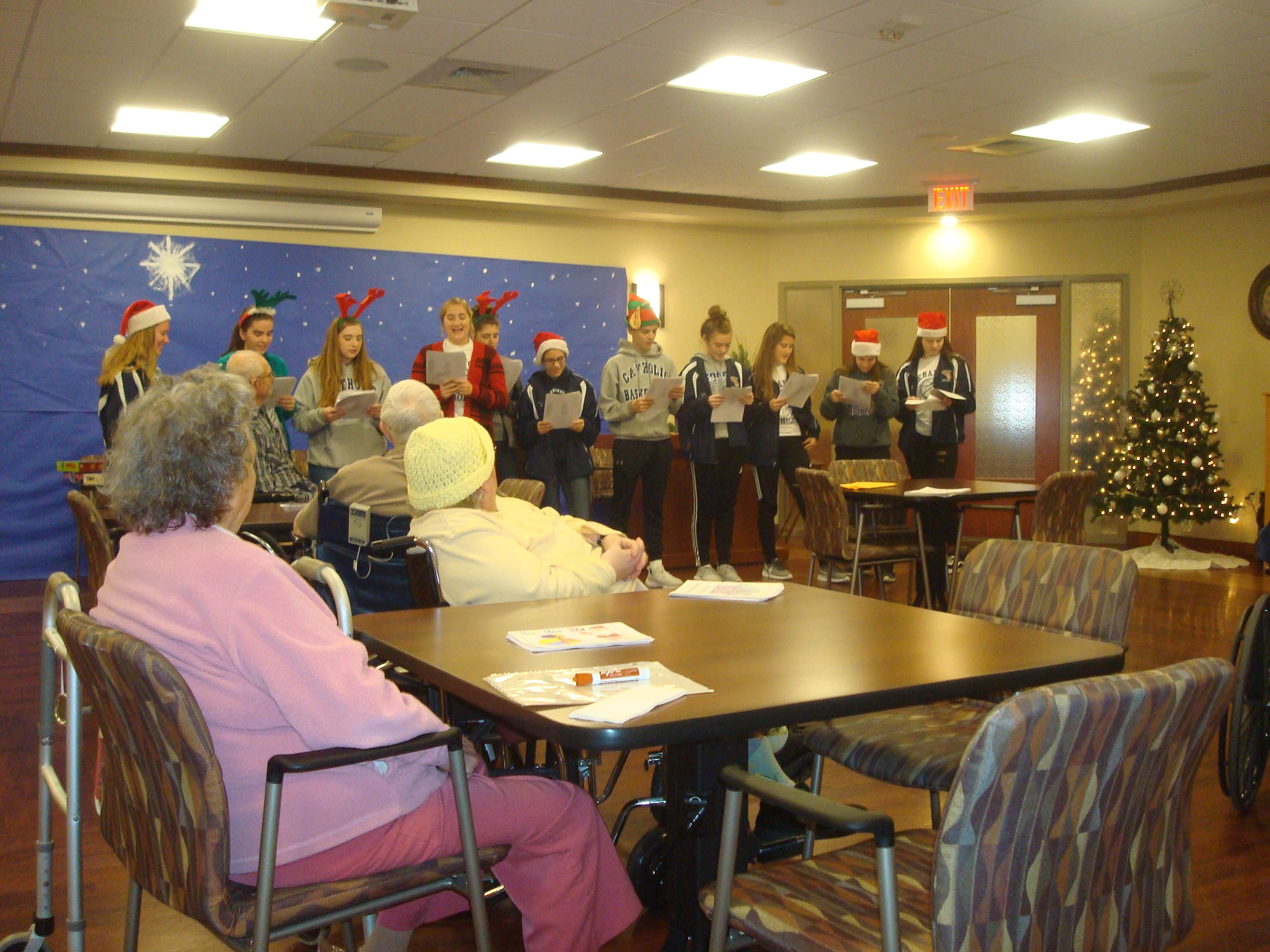 The Lebanon Catholic girls basketball team recently visited Cornwall Manor and sang Christmas carols with the residents.