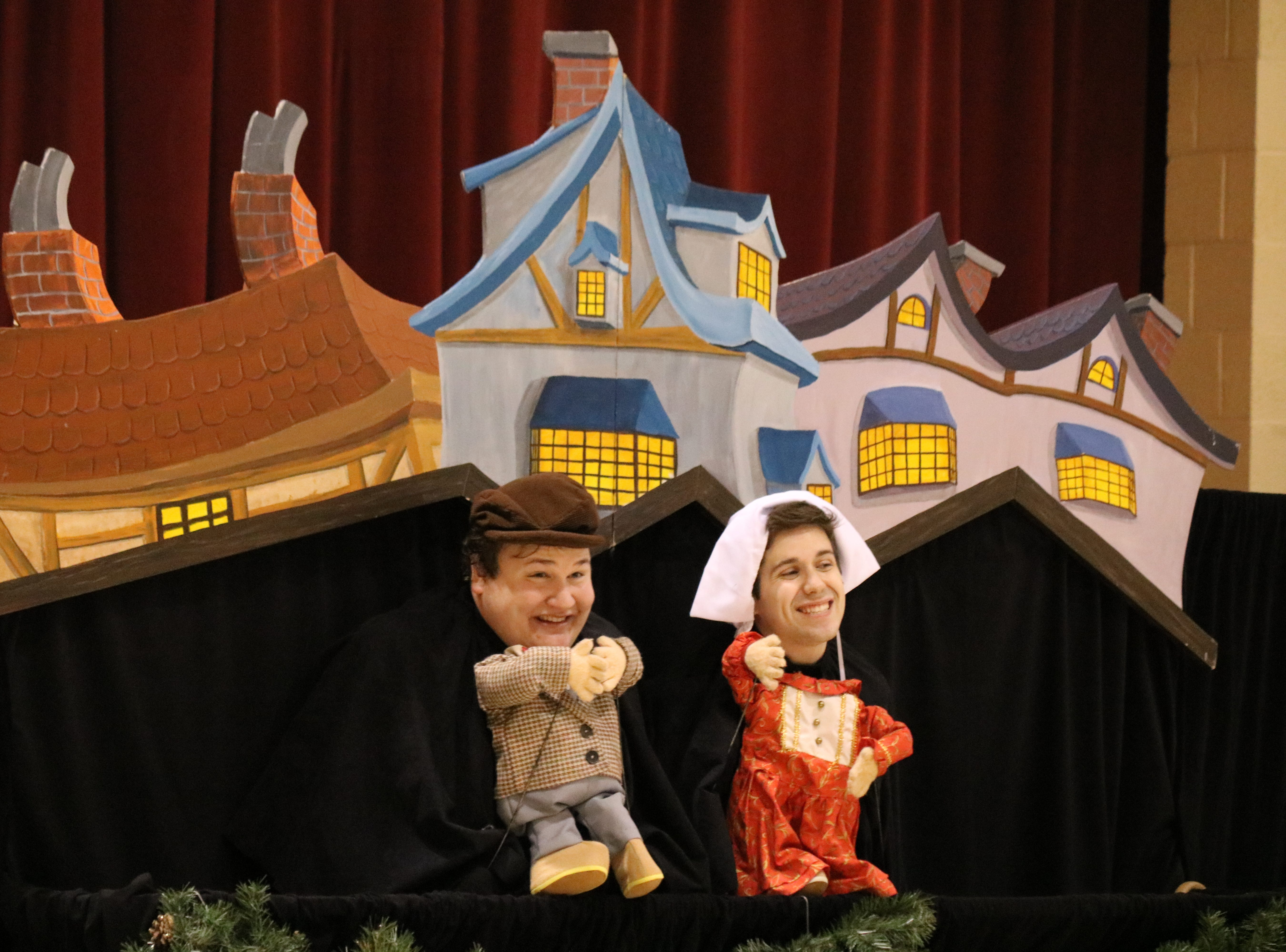 "Zach Robinson, playing the part of young Ebenezer Scrooge, and Brandon Leatherland, playing the part of Belle, tell the tale of ""A Christmas Carol"" for Immaculate Conception School."