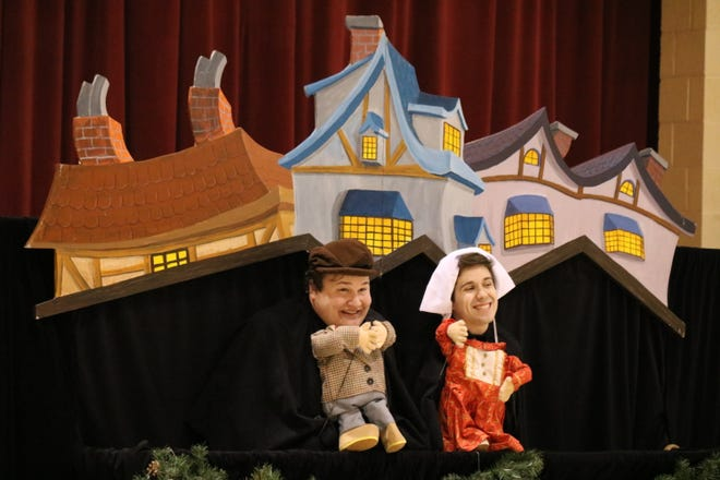 """Zach Robinson, playing the part of young Ebenezer Scrooge, and Brandon Leatherland, playing the part of Belle, tell the tale of """"A Christmas Carol"""" for Immaculate Conception School."""