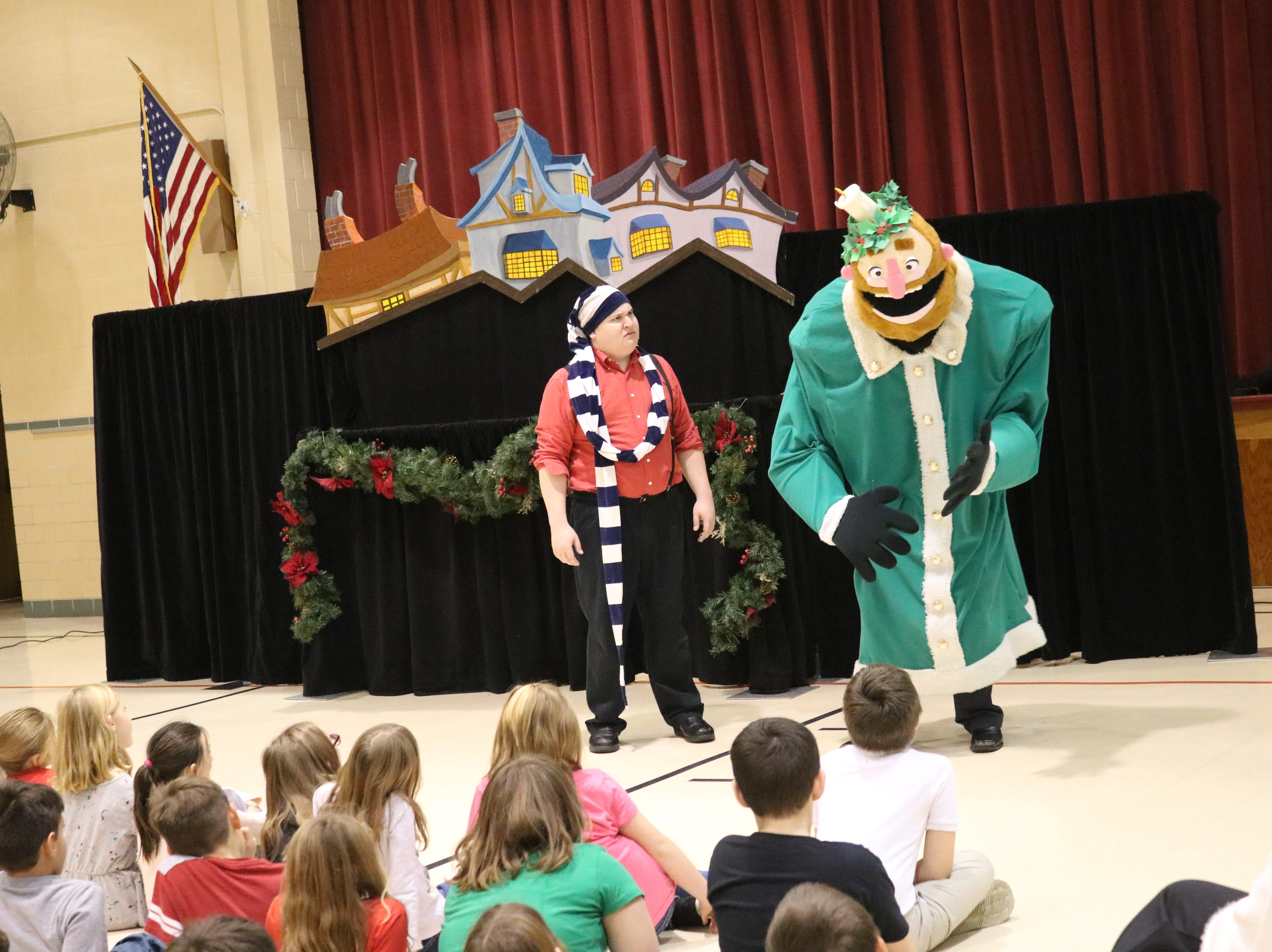 "Zach Robinson and Brandon Leatherland, of Madcap Puppets, perform ""A Christmas Carol"" for Immaculate Conception School on Thursday."