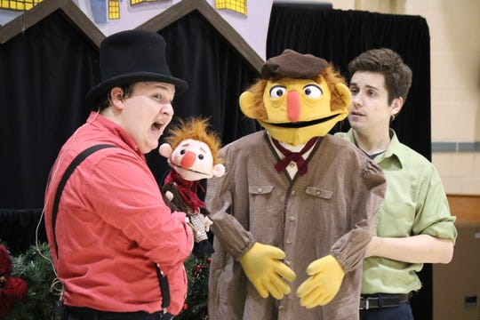 """Zach Robinson and Brandon Leatherland play the roles of Tiny Tim and Bob Cratchit, respectively, as Madcap Puppets performed its version of """"A Christmas Carol"""" at Immaculate Conception School."""