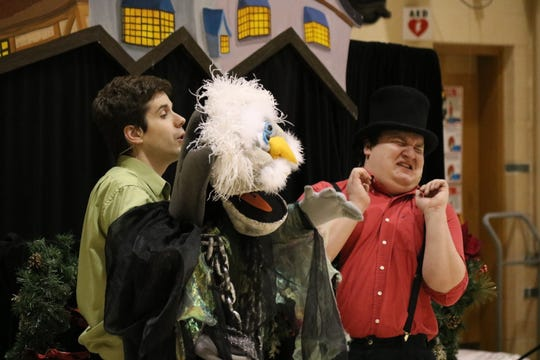 """Zach Robinson and Brandon Leatherland, of Madcap Puppets, perform """"A Christmas Carol"""" for Immaculate Conception School."""