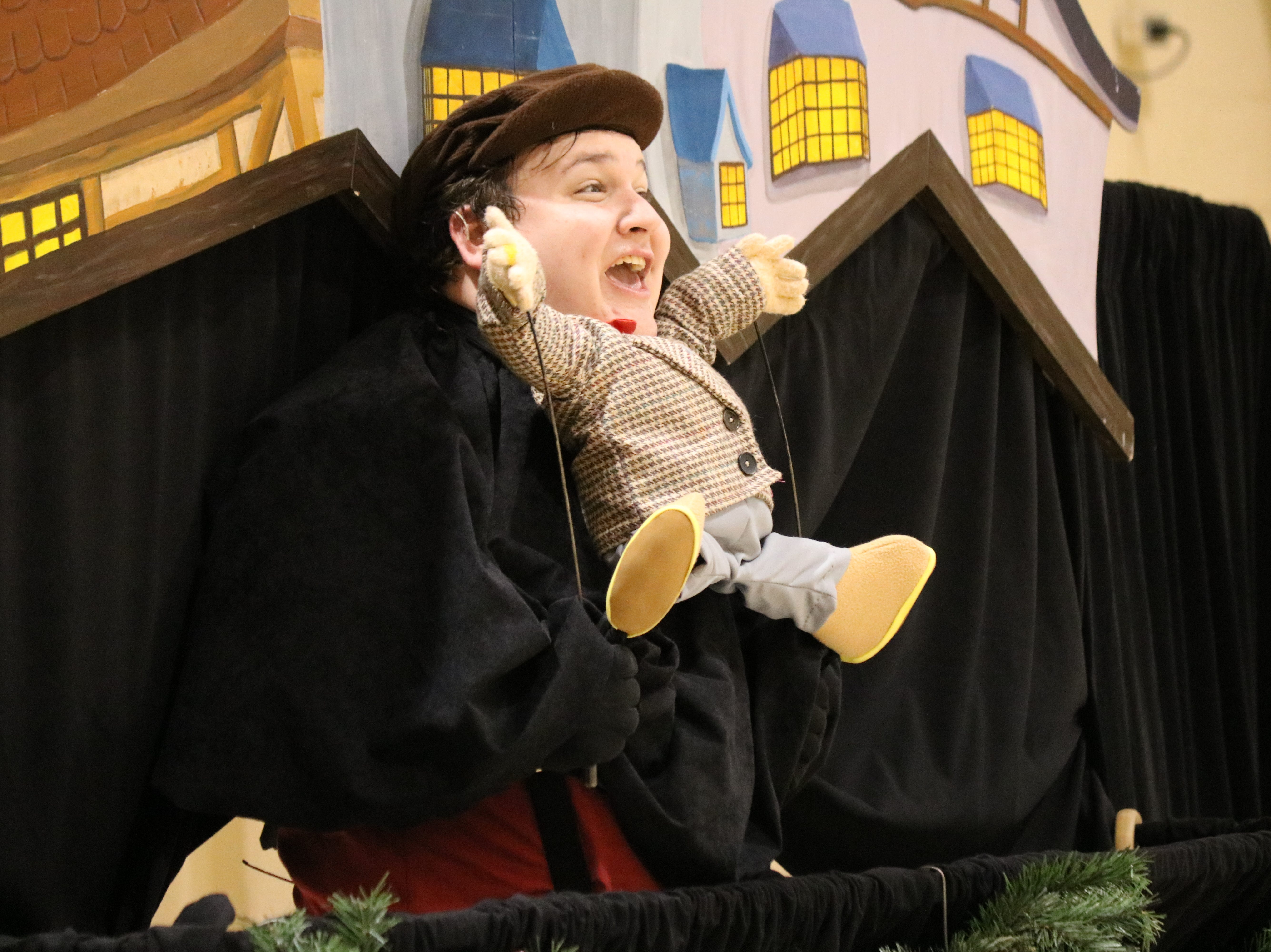 "Zach Robinson plays the part of an excited young Ebenezer Scrooge as Madcap Puppets performed its iteration of ""A Christmas Carol"" for Immaculate Conception School on Thursday."