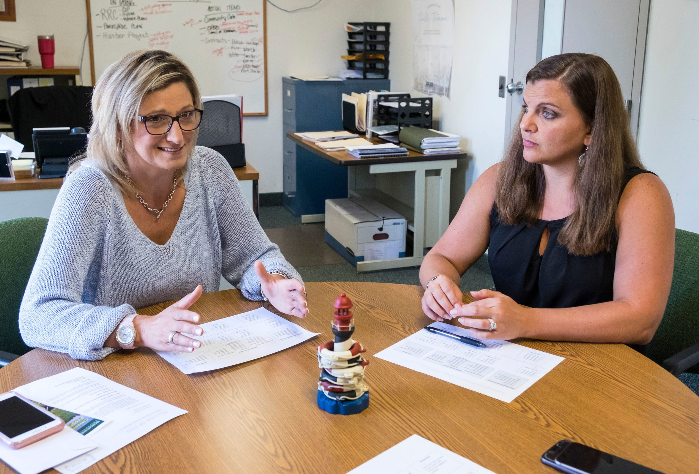 Lexington Village Manager Holly Tatman, right, talks with Kristen Kaatz, the village's president, in her office in July 2018. Tatman began the job as manager last spring and may have the longest commute among administrators in nearby towns, as she resides in St. Clair.