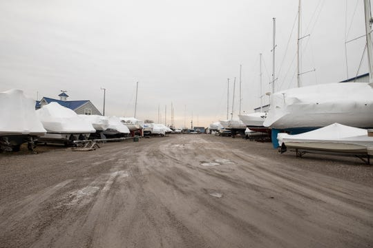 Covered boats are stored outside at Desmond Landing in downtown Port Huron. Acheson Ventures is applying for another special use permit from the city to build an expansion onto the Third Street building, which will double it in size.