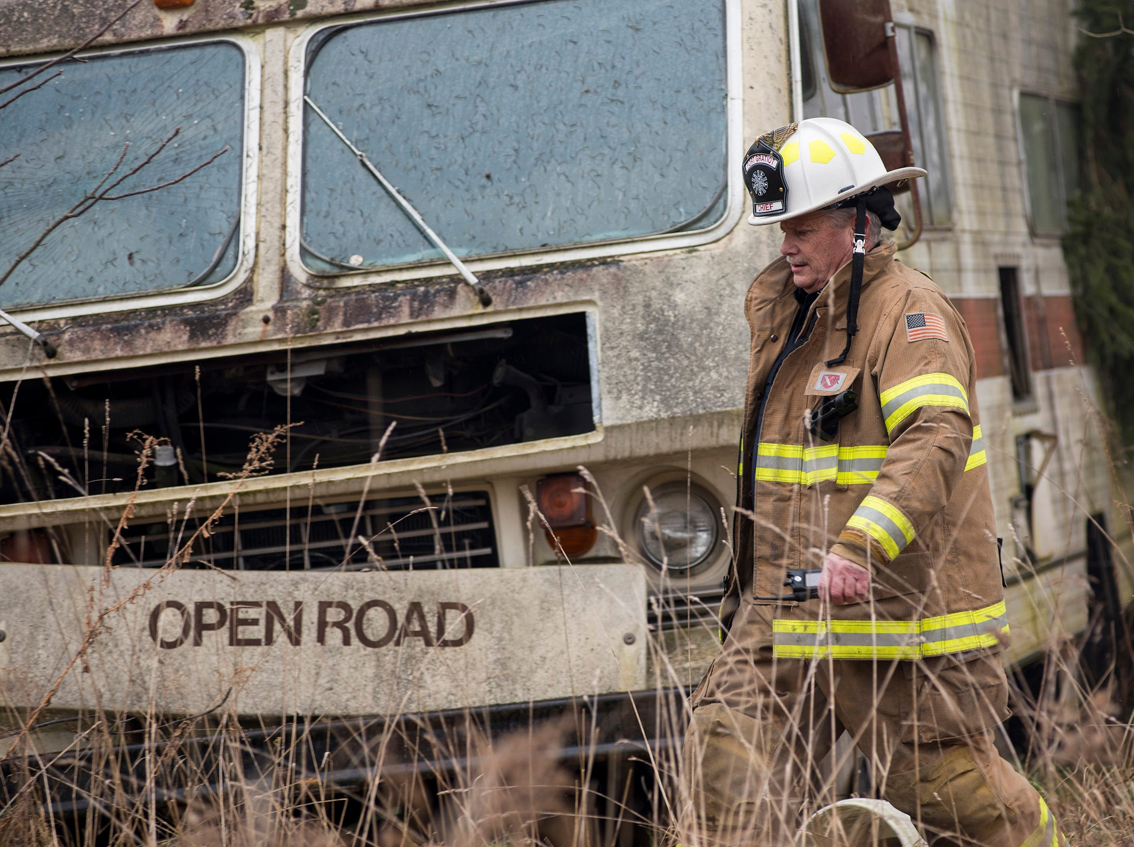 Fort Gratiot Fire Chief Pat Smith walks past an abandoned RV at the scene of a fire in the 3700 block of Brace Road in Fort Gratiot Thursday, Dec. 20, 2018. Firefighters received the call shortly before 1 p.m. The house was abandoned and the cause is under investigation.