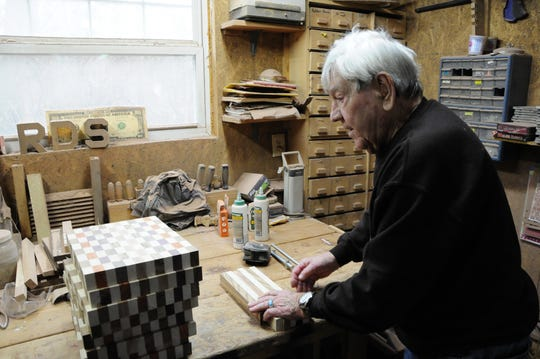 Ray Daggett shows how he puts wood boards together to make cutting boards at his shop in Burtchville Township on Thursday, Dec. 20, 2018.
