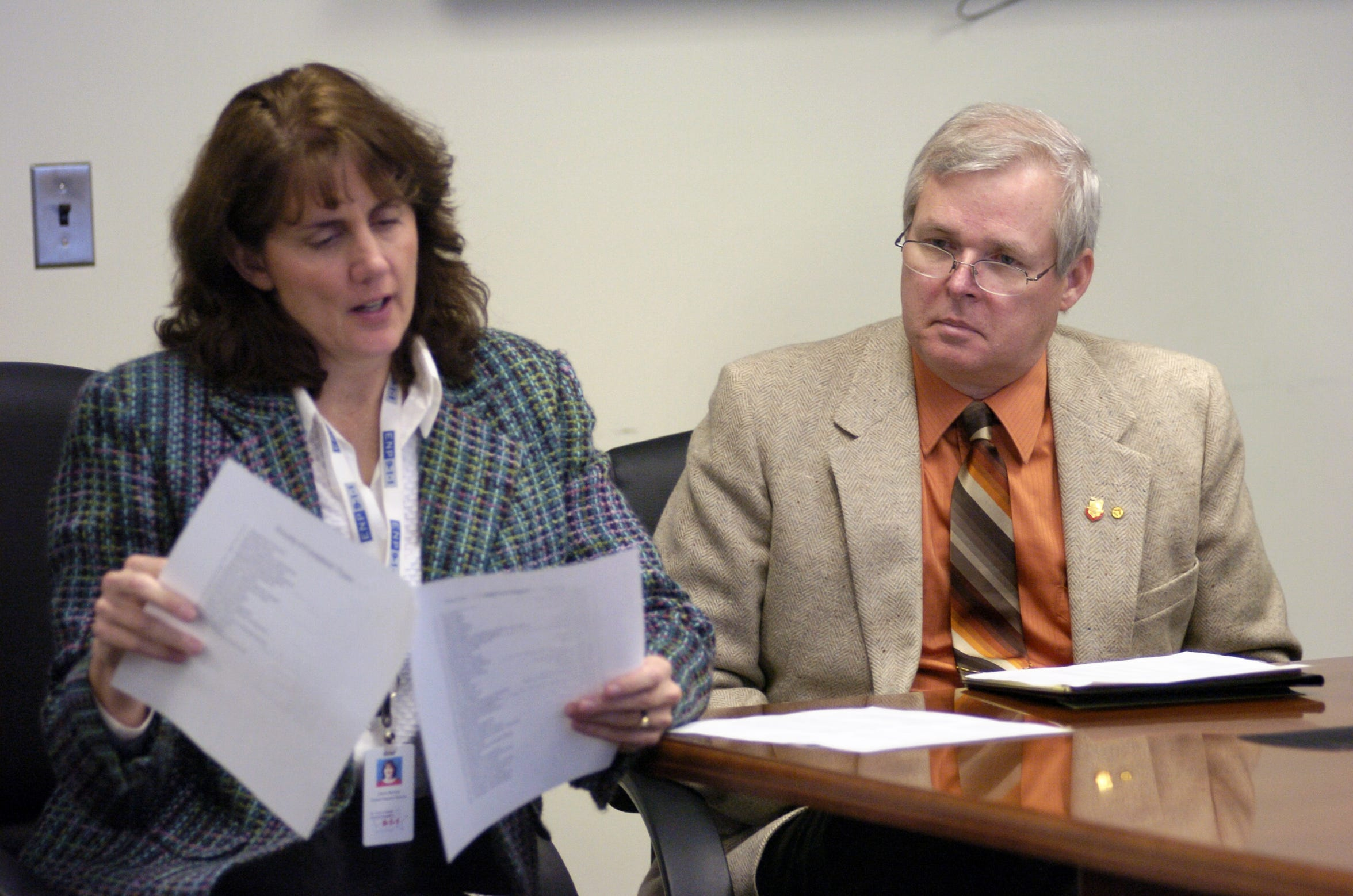 Yale City Manager John Osborn, right, glances at Cherie Bartram, who was then director of the St. Clair County Central Dispatch, in October 2008, during a workshop. Osborn lived in the city of Yale nearly as long as he's been its manager and said he still only lives two miles outside its limits.