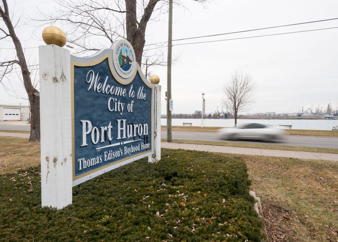 A sign welcoming people to Port Huron sits in a park on Military Street.