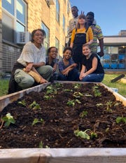 Members of the Poughkeepsie Middle School Garden Club pose with a strawberry bed. Top row, from left, Darrian Black, Jenna Merced and Kamali Henry. Bottom row, from left, Alyssa Vilela, Jessica Brown, Chelsea Brown and Schuyler Birritella.