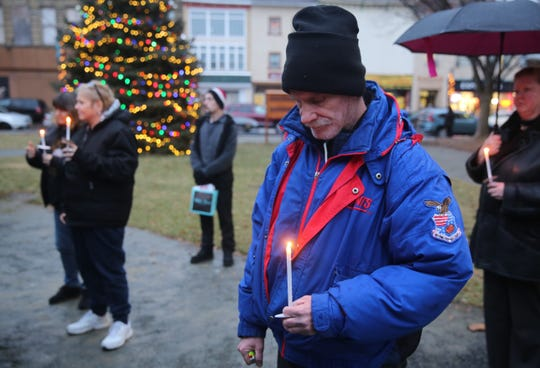 Duane Byble, a formerly homeless city of Poughkeepsie resident, holds a candle on Thursday at a vigil marking Homeless Persons' Remembrance Day. He said little acts of kindness go a long way when someone's homeless.