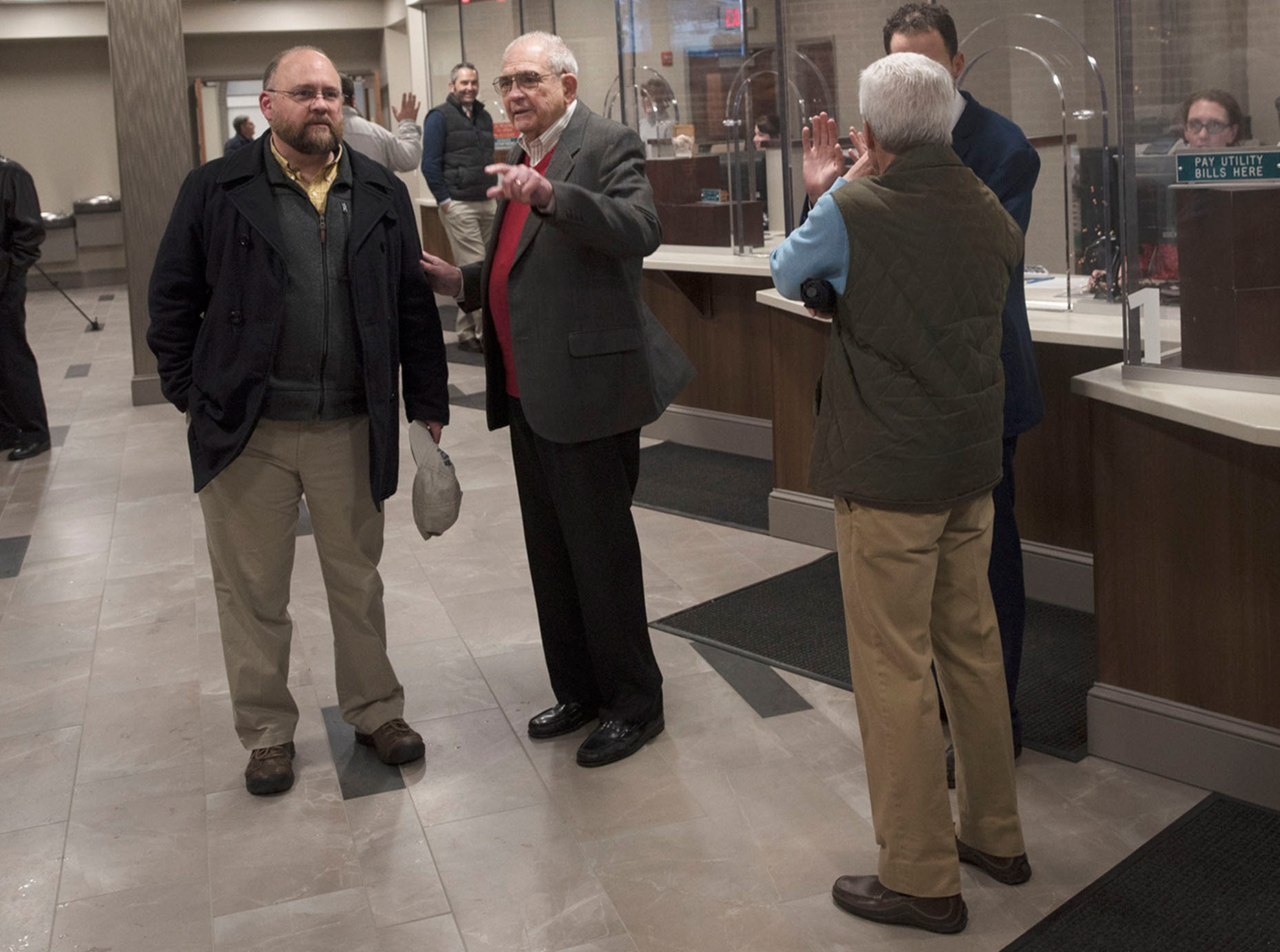 Former Chambersburg Boro manager Julio Lecuona, center, tours the new boro hall addition with others after a ribboncutting ceremony on Thursday, December 20, 2018.