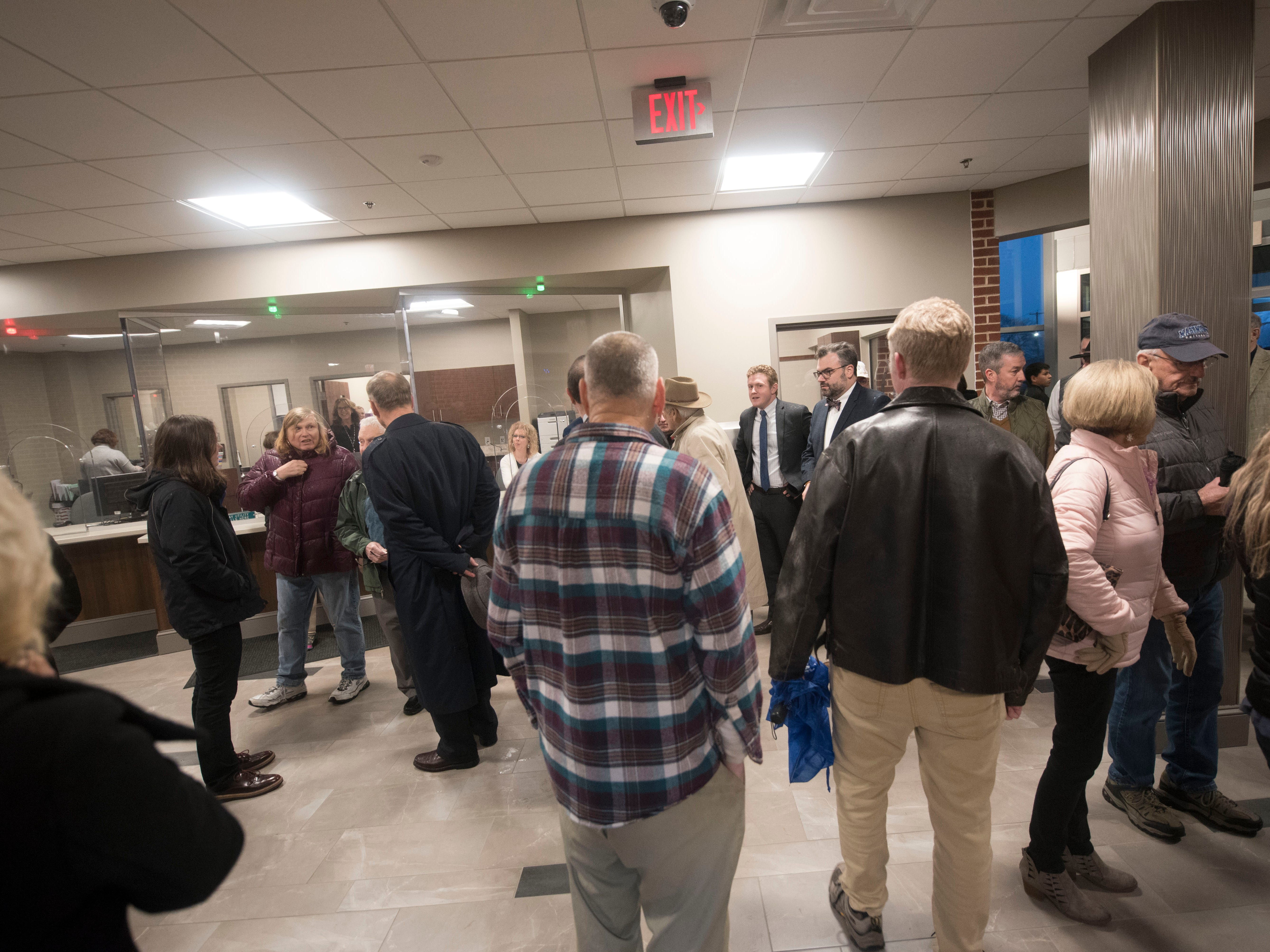Former employees and others tour the new boro hall addition with others after a ribboncutting ceremony on Thursday, December 20, 2018.