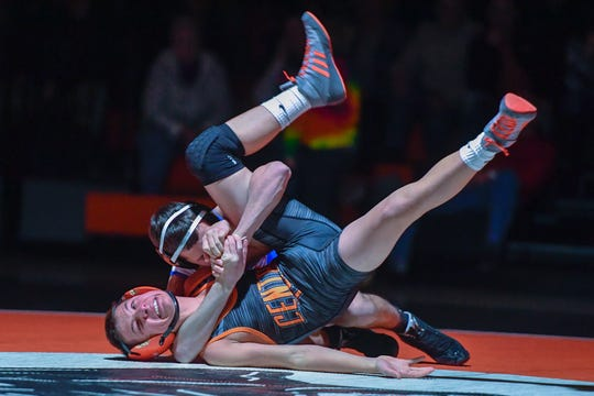 Spring Grove's Sam Meyer locks in the cradle on Brendan Smith of Central York during the 113 pound match, Wednesday, December 19, 2018.John A. Pavoncello photo