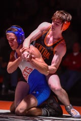 Spring Grove's Brady Pitzer tries to break free of Joseph Musti of Central York during the 145 pound match, Wednesday, December 19, 2018.John A. Pavoncello photo
