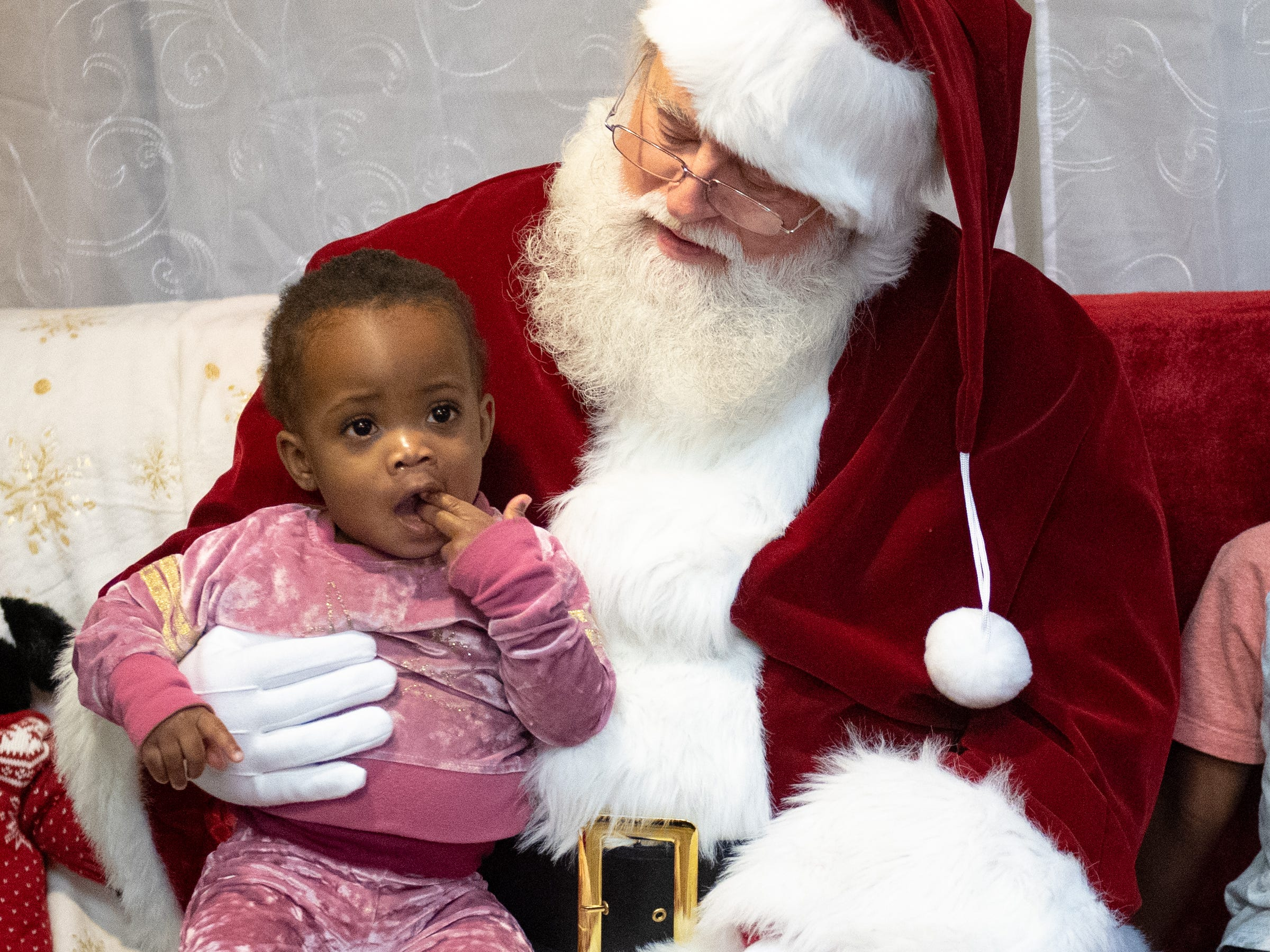 Amelia Cox, 1, takes the whole experience in during the Dinner with Santa and Santa Cow event at Chick-fil-A in East York, December 19, 2018.