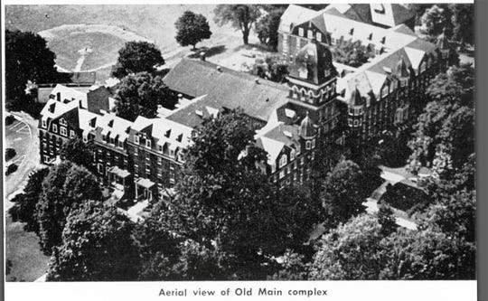 Old Main at the Millersville Normal School, now Millersville University. Old Main was torn down in the 1960's. McHenry hid the desk in his dorm room after salvaging it from a trash room.