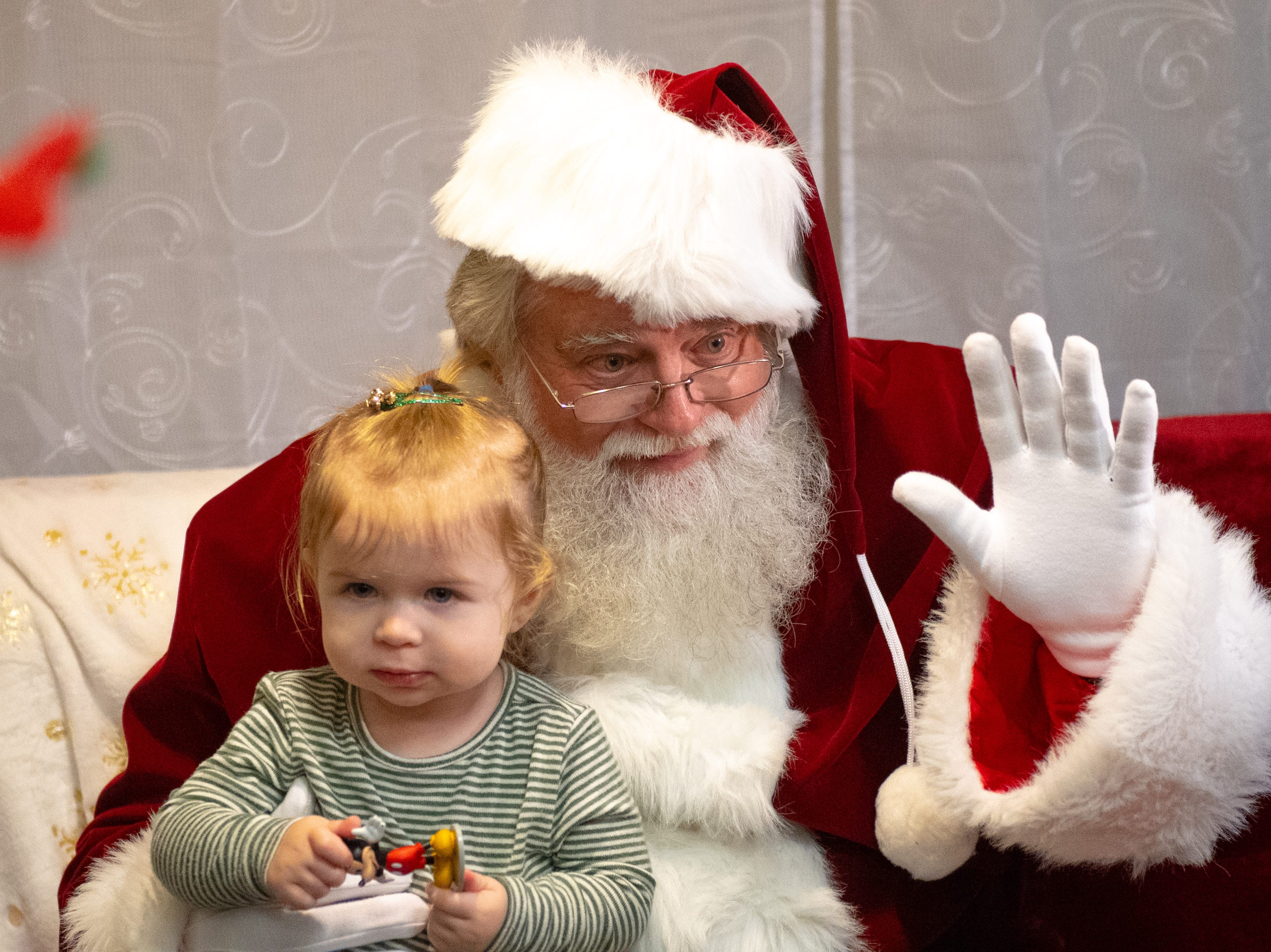 Josephine Buracker, 1, of West Manchester Township looks everywhere but the camera during the Dinner with Santa and Santa Cow event at Chick-fil-A in East York, December 19, 2018.