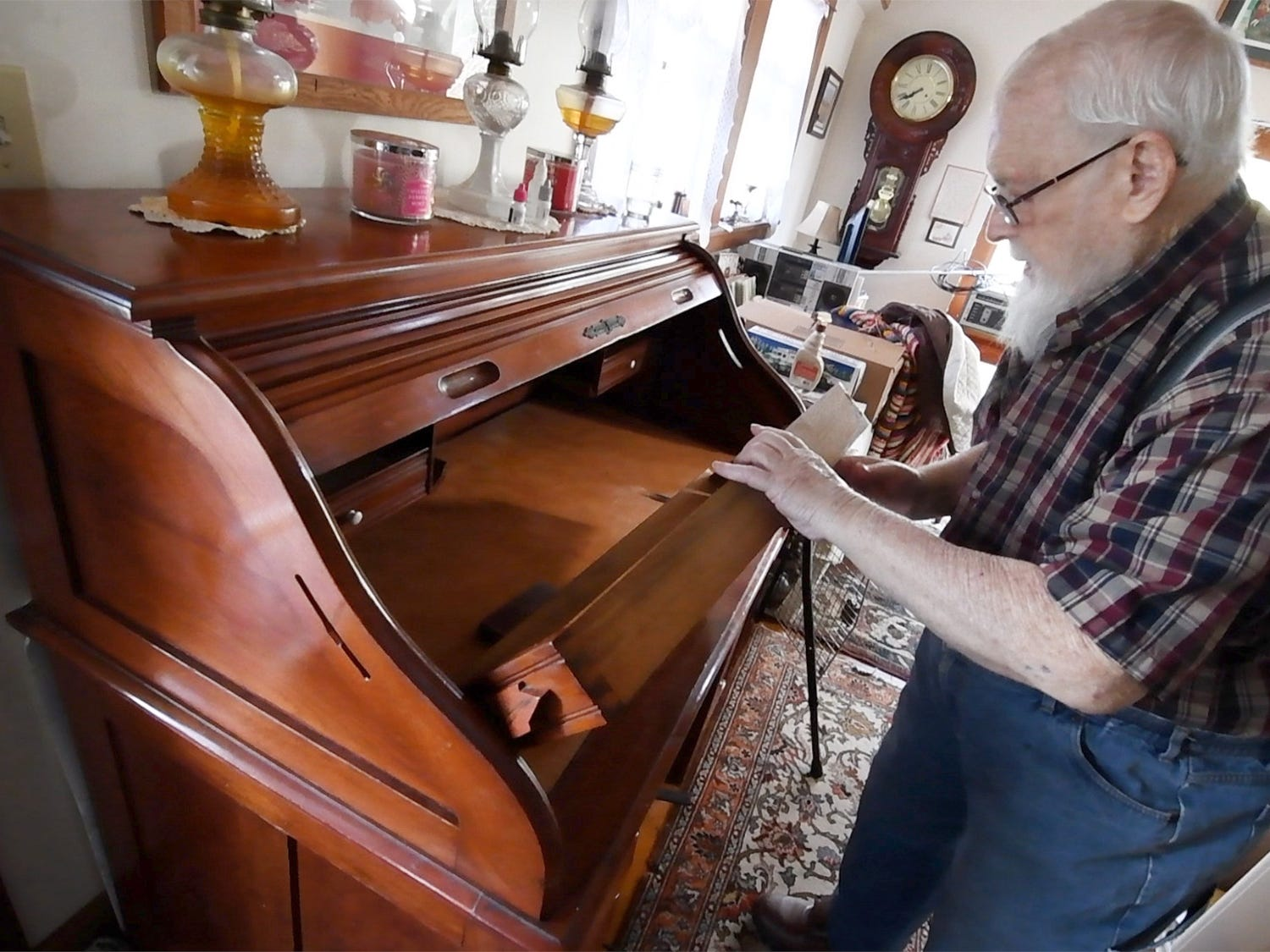 John McHenry looks over a drawer at his home in Jacous Wednesday December 19, 2018. The desk is stamped with a manufacturing date of 1888.