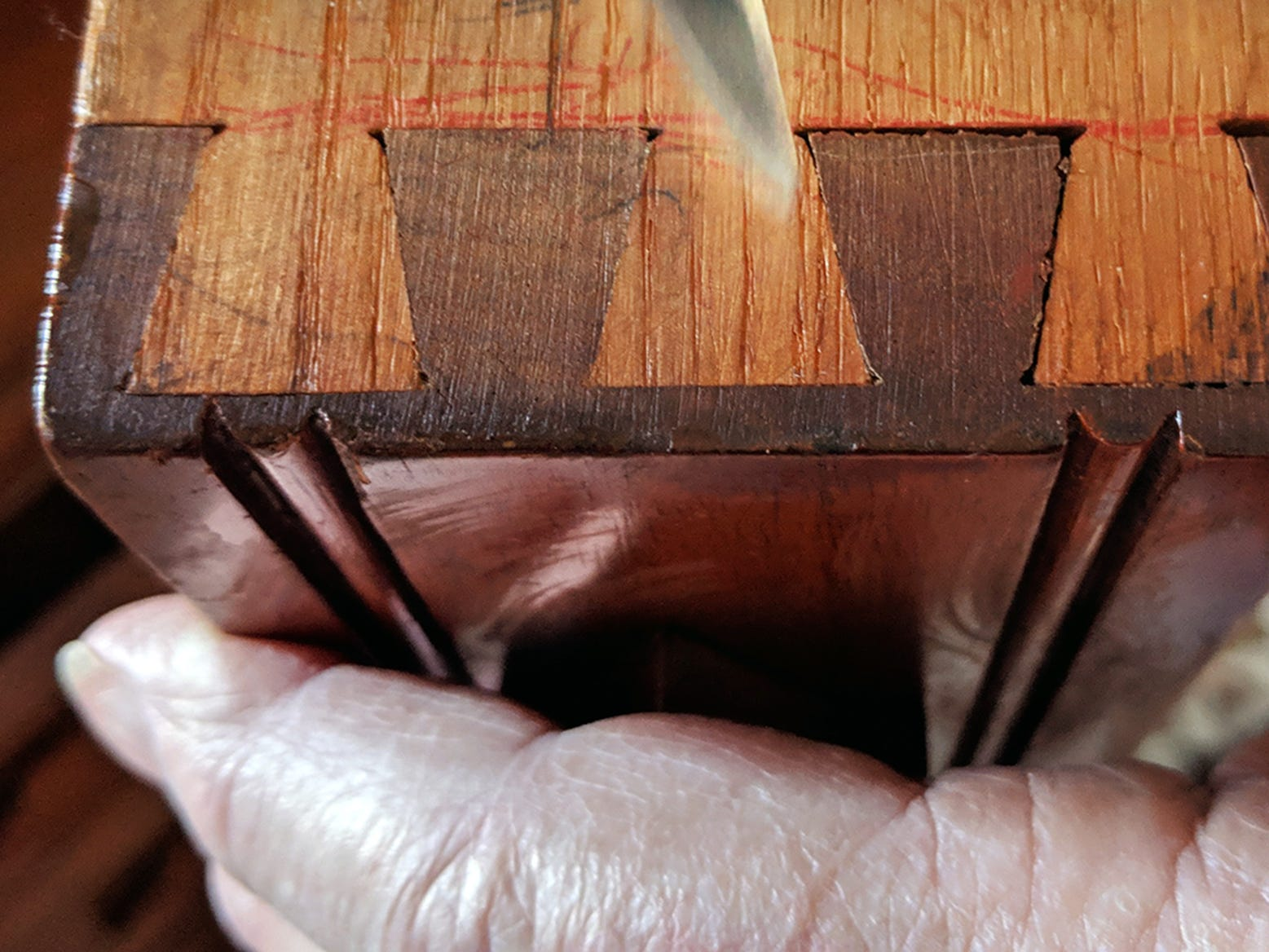 John McHenry holds one of the drawers showing the dovetail joints.