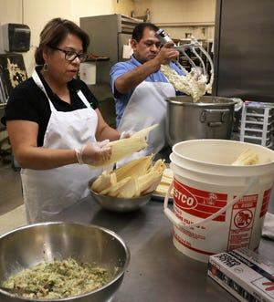 Panaderia Las Palomas owners Maria and Merced Perez make tamales in their bakery in Reno on Dec. 19, 2018.